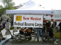 Photo of MRC Tent and volunteers at event.